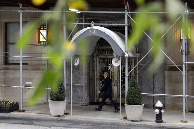 A man passes the Park Avenue residence of billionaire industrialist David H. Koch, in New York, Friday, Aug. 23, 2019. Koch, who with his older brother Charles, was both celebrated and demonized for transforming American politics by pouring their riches into conservative causes, died Friday at 79. (AP Photo/Richard Drew)