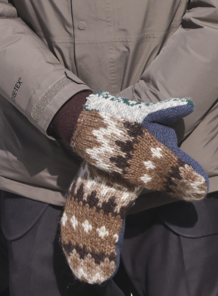 FILE - In this Jan. 20, 2021 file photo, Sen. Bernie Sanders, I-Vt., wears mittens as he attends President Joe Biden's inauguration ceremony at the U.S. Capitol in Washington. Sanders says the wooly mittens he wore to the ceremony that sparked endless quirky memes across social media have helped to raise $1.8 million in the last five days for charitable organizations in his home state of Vermont through the sale of T-shirts, sweatshirts and stickers with the iconic image of him sitting with his arms and legs crossed in his brown parka and recycled wool mittens. (Jonathan Ernst/Pool Photo via AP)