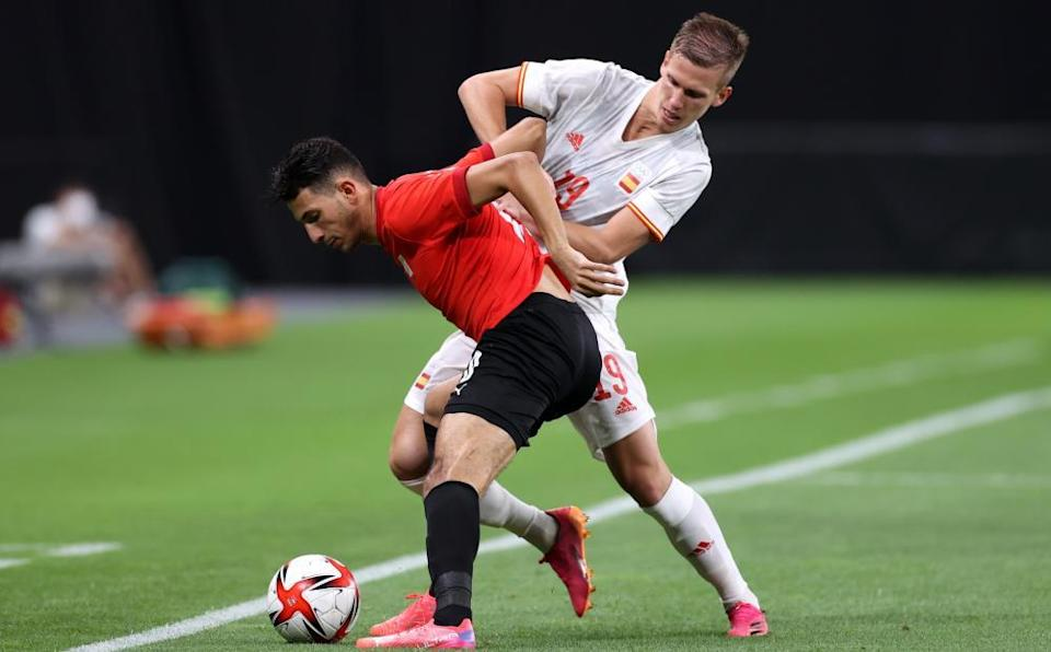 Dani Olmo, another of the Spain Euro 2020 squad playing at the Olympics, battles with Ahmed Fotouh.