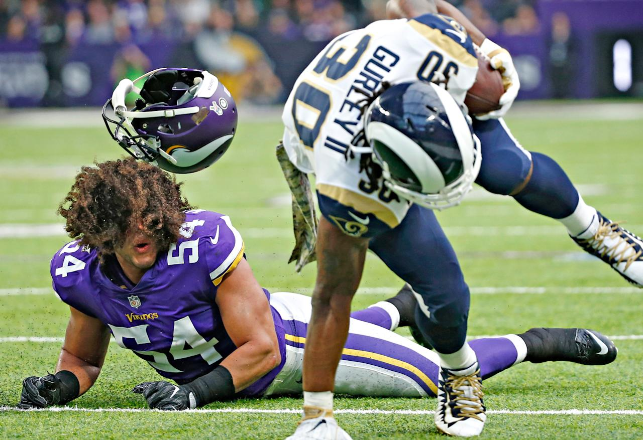 <p>Minnesota Vikings middle linebacker Eric Kendricks, left, loses his helmet as he chases Los Angeles Rams running back Todd Gurley (30) during the first half of an NFL football game, Sunday, Nov. 19, 2017, in Minneapolis. (AP Photo/Bruce Kluckhohn) </p>