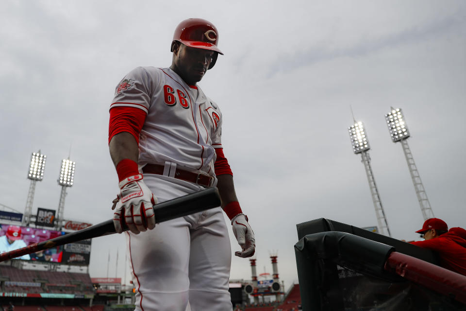 Cincinnati Reds' Yasiel Puig walks back into the dugout after striking out against Atlanta Braves starting pitcher Julio Teheran in the third inning of a baseball game, Thursday, April 25, 2019, in Cincinnati. (AP Photo/John Minchillo)