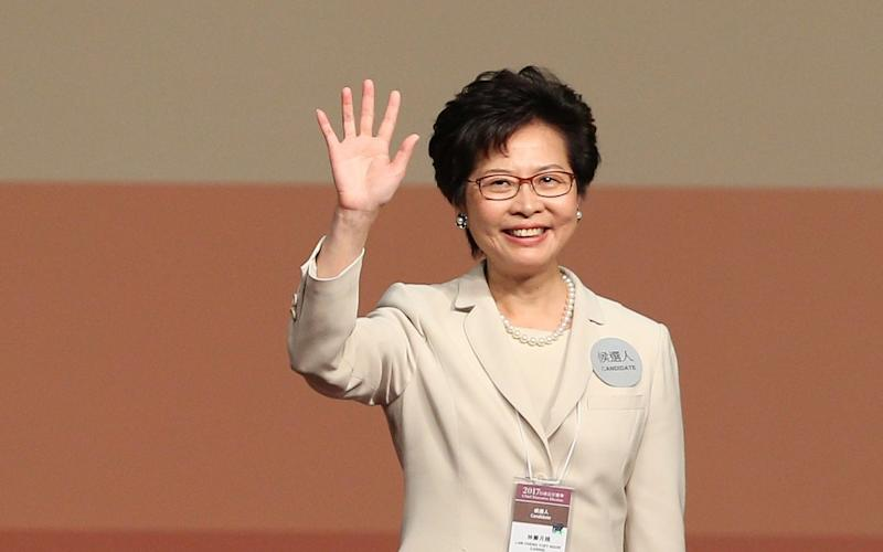 Carrie Lam waves after her victory - EPA