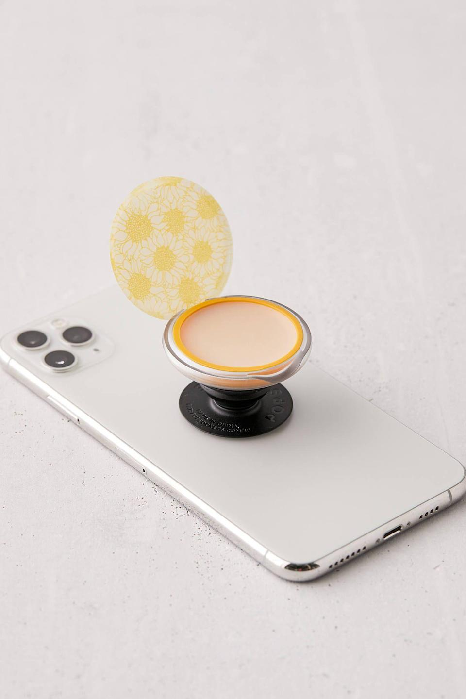 """<p><strong>PopSockets</strong></p><p>urbanoutfitters.com</p><p><strong>$20.00</strong></p><p><a href=""""https://go.redirectingat.com?id=74968X1596630&url=https%3A%2F%2Fwww.urbanoutfitters.com%2Fshop%2Fpopsockets-poplips-burts-bees-lip-balm-phone-stand&sref=https%3A%2F%2Fwww.countryliving.com%2Fshopping%2Fgifts%2Fg36340375%2Funique-graduation-gifts%2F"""" rel=""""nofollow noopener"""" target=""""_blank"""" data-ylk=""""slk:Shop Now"""" class=""""link rapid-noclick-resp"""">Shop Now</a></p><p>Pop Sockets always come in handy, and this one is even more useful. It holds a stash of Burt's Bees lip balm so she's never without.</p>"""