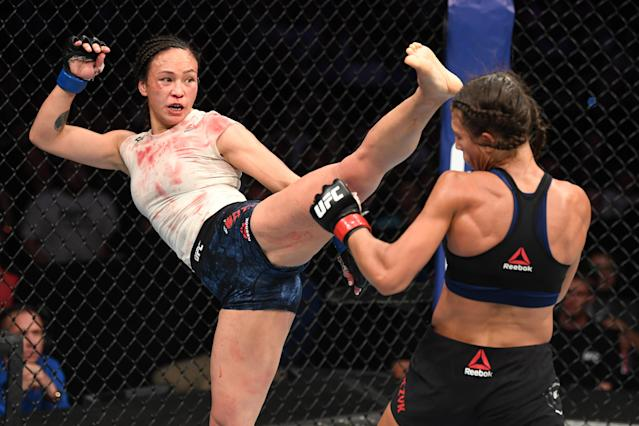 Michelle Waterson kicks Joanna Jedrzejczyk in their women's strawweight bout during UFC Fight Night at Amalie Arena on Oct. 12, 2019 in Tampa, Florida. (Photo by Josh Hedges/Zuffa LLC via Getty Images)