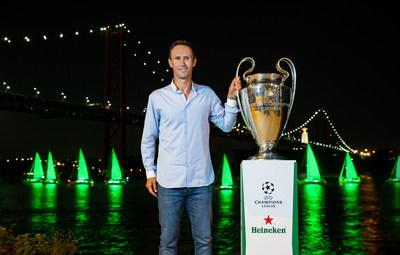 UEFA ambassador and former UEFA Champions League winner Ricardo Carvalho stands beside the trophy on the banks of the Rio Tejo, as Heineken® 'paints' Lisbon green to celebrate the tournament's return.