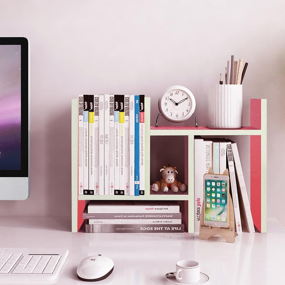 """<p>Your home office will be so much more organized and productive with this <product href=""""https://www.amazon.com/Jerry-Maggie-Desktop-Organizer-Adjustable/dp/B077V8PS3M/ref=asc_df_B077V8PS3M/?tag=hyprod-20&amp;linkCode=df0&amp;hvadid=242115926391&amp;hvpos=1o1&amp;hvnetw=g&amp;hvrand=1904879281248546974&amp;hvpone=&amp;hvptwo=&amp;hvqmt=&amp;hvdev=c&amp;hvdvcmdl=&amp;hvlocint=&amp;hvlocphy=9004356&amp;hvtargid=pla-396129141536&amp;psc=1"""" target=""""_blank"""" class=""""ga-track"""" data-ga-category=""""Related"""" data-ga-label=""""https://www.amazon.com/Jerry-Maggie-Desktop-Organizer-Adjustable/dp/B077V8PS3M/ref=asc_df_B077V8PS3M/?tag=hyprod-20&amp;linkCode=df0&amp;hvadid=242115926391&amp;hvpos=1o1&amp;hvnetw=g&amp;hvrand=1904879281248546974&amp;hvpone=&amp;hvptwo=&amp;hvqmt=&amp;hvdev=c&amp;hvdvcmdl=&amp;hvlocint=&amp;hvlocphy=9004356&amp;hvtargid=pla-396129141536&amp;psc=1"""" data-ga-action=""""In-Line Links"""">Desktop Organizer</product> ($24)!</p>"""