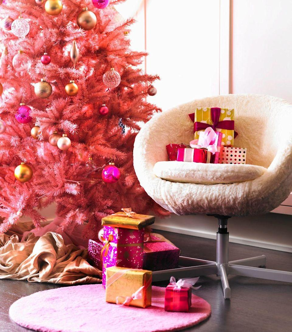 <p>Make a playful statement this year with a vibrant pink tree. The eye-catching color complements nearly all holiday palettes, lending a funky feel that will enliven the festivities.</p>