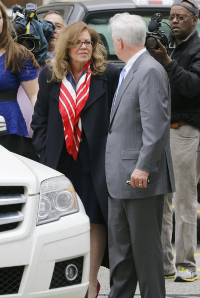 """Former state Supreme Court Justice Joan Orie Melvin, left, talks with Daniel Brier, one of her defense attorneys, after she and her sister, Janine Orie, were sentenced for their February convictions on corruption in Orie Melvin's election campaign, on Tuesday, May 7, 2013, in Pittsburgh. The sisters avoided prison time but were sentenced to house arrest for what a judge called crimes of """"arrogance."""" (AP Photo/Keith Srakocic)"""