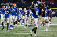 Florida players celebrate a Florida running back Nay'Quan Wright (6) touchdown against Alabama during the second half of the Southeastern Conference championship NCAA college football game, Saturday, Dec. 19, 2020, in Atlanta. (AP Photo/Brynn Anderson)