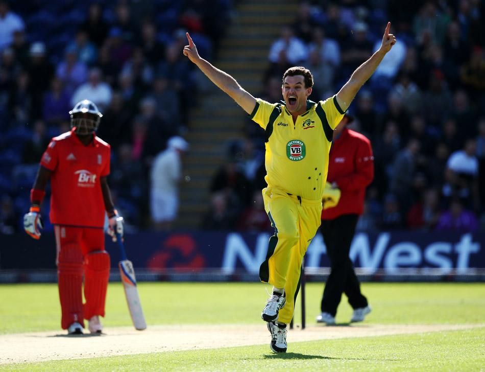 Australia's bowler Clint McKay (R) celebrates taking the wicket of England's Joe Root (not pictured) for the third wicket of a hat-trick during the fourth one day international (ODI) cricket match between England and Australia at the SWALEC stadium in Cardiff, south Wales on September 14, 2013. AFP PHOTO / ADRIAN DENNIS -- RESTRICTED TO EDITORIAL USE. NO ASSOCIATION WITH DIRECT COMPETITOR OF SPONSOR, PARTNER, OR SUPPLIER OF THE ECB        (Photo credit should read ADRIAN DENNIS/AFP/Getty Images)