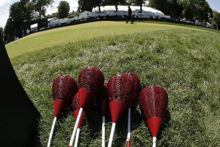 Ian Poulter, of England, walks past wicker baskets during practice for the U.S. Open golf tournament at Merion Golf Club, Wednesday, June 12, 2013, in Ardmore, Pa. (AP Photo/Charlie Riedel)