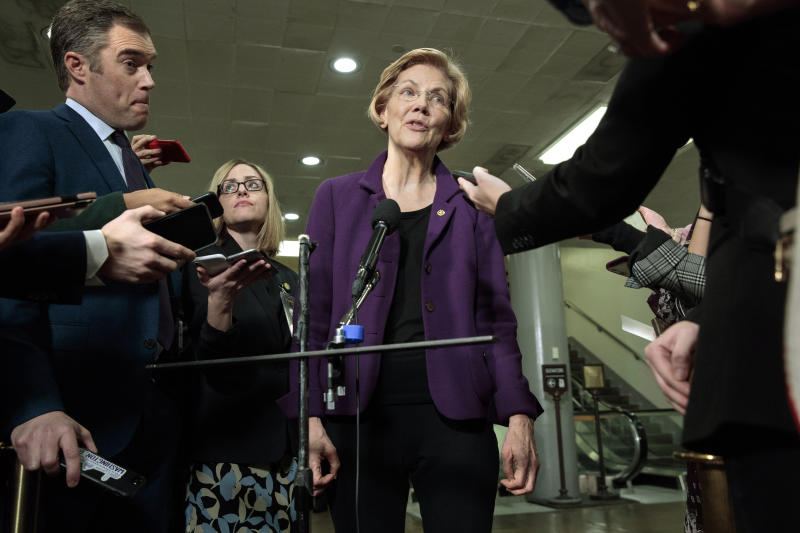 Democratic Presidential candidate Sen. Elizabeth Warren, D-Mass., speaks to the media before attending the impeachment trial of President Donald Trump on charges of abuse of power and obstruction of Congress, Thursday, Jan. 23, 2020, on Capitol Hill in Washington. (AP Photo/ Jacquelyn Martin)