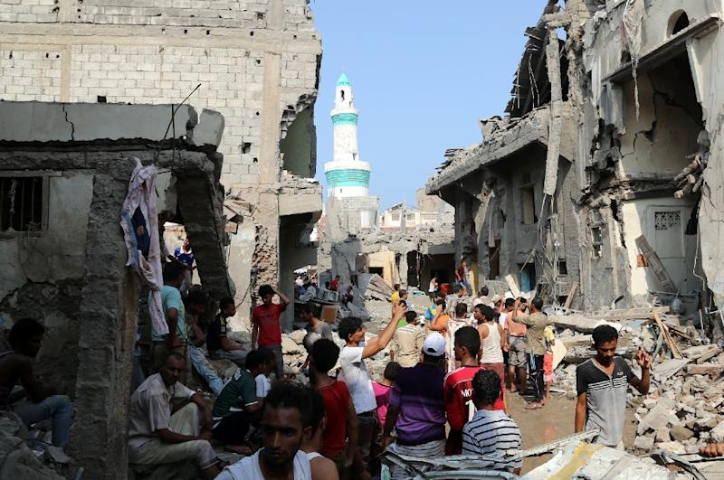 Yemenis gather on September 22, 2016 amidst the rubble of buildings destroyed during Saudi-led air strikes in the rebel-held Yemeni port city of Hodeida the previous day