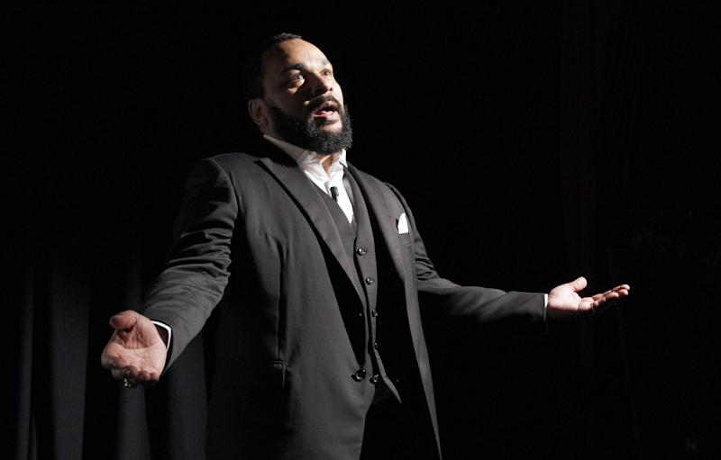 A photo taken on January 15, 2012 shows French comedian Dieudonne delivering a speech in Paris (AFP Photo/Patrick Kovarik)