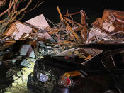 A damaged vehicle sits among debris after a deadly tornado tore through Brunswick County, N.C., Tuesday, Feb. 16, 2021. North Carolina authorities say multiple people are dead and others were injured after a tornado ripped through Brunswick County, leaving a trail of heavy destruction. (Emily Flax/Brunswick County Sheriff's Office via AP)