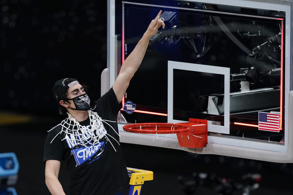 UCLA Bruins guard Jaime Jaquez Jr. celebrates after an Elite 8 game against Michigan in the NCAA men's college basketball tournament at Lucas Oil Stadium, Wednesday, March 31, 2021, in Indianapolis. UCLA won 51-49. (AP Photo/Michael Conroy)
