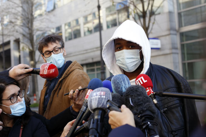 Music producer identified only by his first name, Michel, answers to media, before going to the Inspectorate General of the National Police, known by its French acronym IGPN, in Paris, Thursday, Nov. 26, 2020. French Interior Minister Gerald Darmanin ordered several Paris police officers suspended after the publication of videos showing them beating up a Black man and using tear gas against him with no apparent reason. (AP Photo/Thibault Camus)