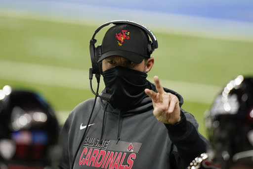 Ball State head coach Mike Neu talks to his team during the first half of the Mid-American Conference championship NCAA college football game against Buffalo, Friday, Dec. 18, 2020, in Detroit. (AP Photo/Carlos Osorio)