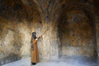 A female artist volunteer cleans a room of the long-abandoned 200-year-old al-Kamalaia school, in the old quarter of Gaza City, Sunday, Dec. 20, 2020. Less than 200 of these old houses are still partly or entirely standing, according to officials and they are threatened by neglect, decaying and urban sprawl. (AP Photo/Adel Hana)