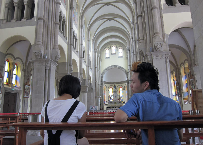 Visitors sit inside of Sheshan seminary Wednesday July 11, 2012 on the outskirts of Shanghai, China. Newly ordained Chinese bishop Ma Daqin has been placed in isolation after announcing he's quitting his government posts in a challenge to Beijing's control over the Catholic clergy, a Hong Kong church activist and Catholic websites said Tuesday. Ma was being confined at the seminary without contact with others, according to the sources. (AP Photo/Eugene Hoshiko)