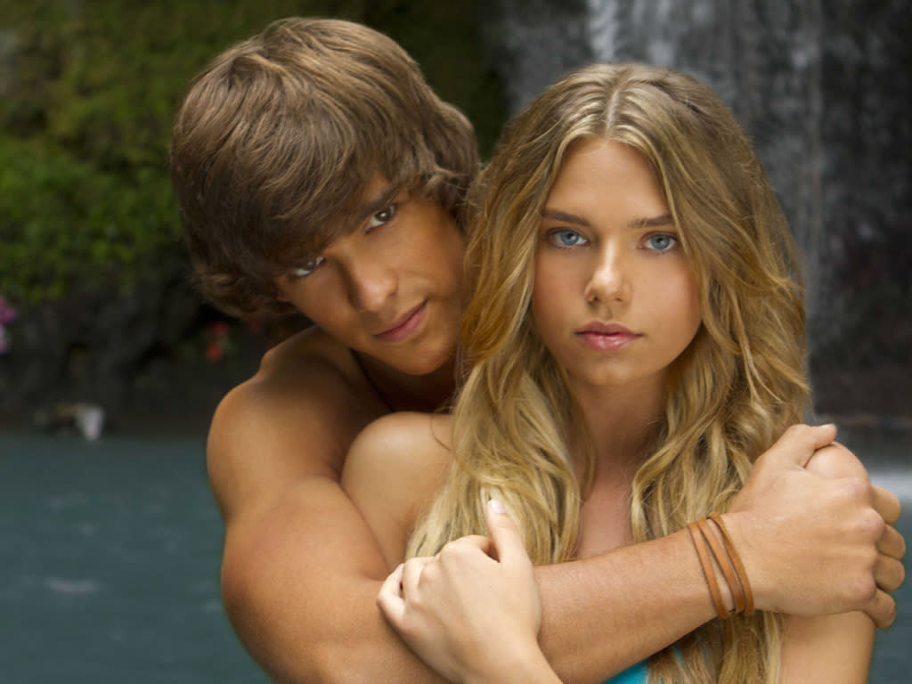 "Brenton Thwaites (""Dean"") and Indiana Evans (""Emma"") star in the all-new Lifetime Original Movie, ""Blue Lagoon: The Awakening."""