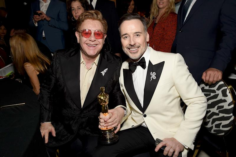 "WEST HOLLYWOOD, CALIFORNIA - FEBRUARY 09: (L-R) Winner of Academy Award for Best Original Song from ""Rocketman"" Elton John and David Furnish attend the 28th Annual Elton John AIDS Foundation Academy Awards Viewing Party sponsored by IMDb, Neuro Drinks and Walmart on February 09, 2020 in West Hollywood, California. (Photo by Michael Kovac/Getty Images for EJAF)"