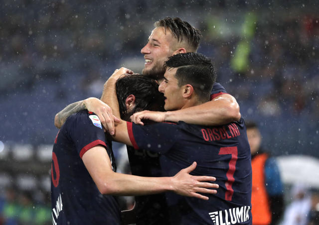 Bologna's Andrea Poli, left, celebrates with Bologna's Riccardo Orsolini after scoring his side's first goal during an Italian Serie A soccer match between Lazio and Bologna, at the Olympic stadium in Rome, Monday, May 20, 2019. (AP Photo/Andrew Medichini)
