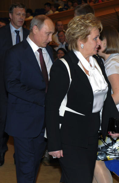 """Russian President Vladimir Putin and his wife Lyudmila attend the ballet """"La Esmeralda"""" in the Kremlin Palace in Moscow, Russia, Thursday, June 6, 2013. Russian President Vladimir Putin and his wife Lyudmila said Thursday they are divorcing after nearly 30 years of marriage, making the announcement on state television after attending a ballet performance at the Kremlin. (AP Photo/RIA-Novosti, Mikhail Klimentyev, Presidential Press Service, Pool)"""
