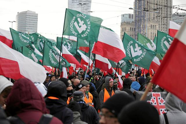 Protesters carry Polish flags and National Radical Camp flags during a rally organized by far-right, nationalist groups to mark the 99th anniversary of Polish independence in Warsaw, Poland, onNov. 11, 2017.