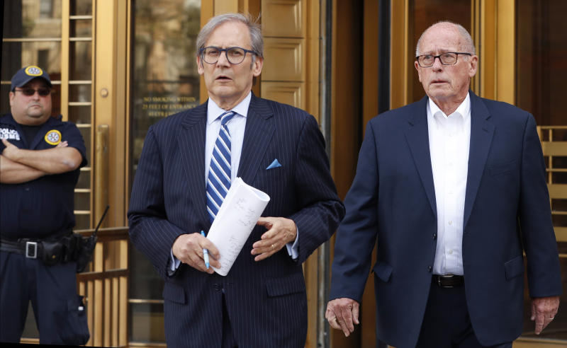 Former Rochester Drug Co-Operative CEO Laurence Doud III, right, leaves US. District Court in Manhattan with his attorney Robert C. Gottlieb, Tuesday, April 23, 2019, in New York. Prosecutors allege Doud ignored red flags to turn his drug distributor into a supplier of last resort as the opioid crisis raged. (AP Photo/Kathy Willens)