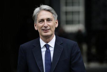 Philip Hammond leaves 10 Downing Street as Britain's Prime Minister David Cameron begins to appoint his cabinet after securing a majority goverment, in central London, May 8, 2015. REUTERS/Kevin Coombs