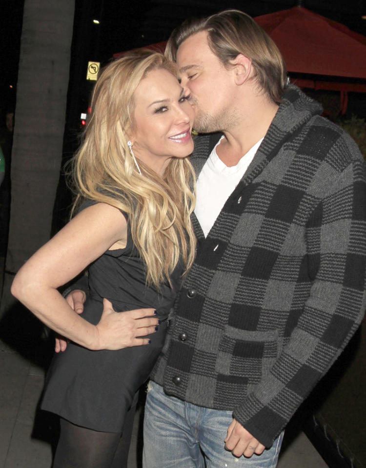 Adrienne Maloof spotted kissing and holding hands with Sean Stewart, the son of rock legend Rod Stewart. The newly separated Maloof from 'Real Housewives of Beverly Hills' was seen smiling, cuddling and kissing the much younger Stewart as they leave Crustacean restaurant in Beverly Hills, CA.