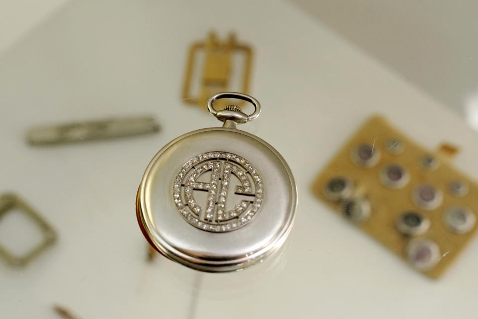 """A platinum and diamond Patek Philippe pocket watch with the initials AC, that once belonged to mob boss Al Capone is seen on display at Witherell's Auction House in Sacramento, Calif., Wednesday, Aug. 25, 2021. The watch is among the 174 family heirlooms that will be up for sale at an Oct. 8 auction titled """"A Century of Notoriety: The Estate of Al Capone,"""" that will be held by Witherell's. (AP Photo/Rich Pedroncelli)"""