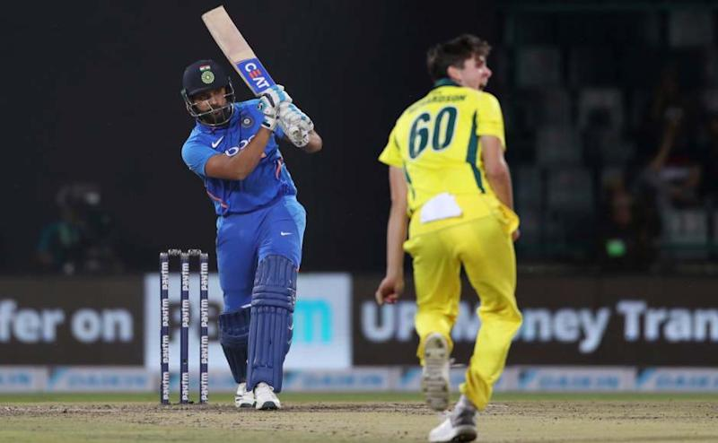 India's Rohit Sharma plays a shot as Australia's Jhye Richardson looks on during the final one day international cricket match between India and Australia in New Delhi, India, Wednesday, March 13, 2019. (AP Photo/Altaf Qadri)