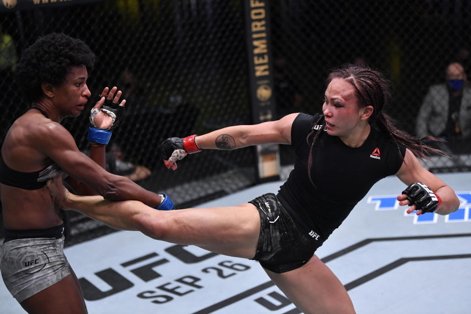 LAS VEGAS, NEVADA - SEPTEMBER 12: (R-L) Michelle Waterson kicks Angela Hill in a strawweight fight during the UFC Fight Night event at UFC APEX on September 12, 2020 in Las Vegas, Nevada. (Photo by Jeff Bottari/Zuffa LLC)