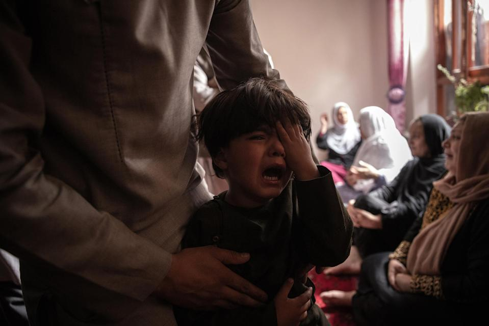 """A boy cries over the death of his sister in the drone strike.<span class=""""copyright"""">Jim Huylebroek—The New York Times/Redux</span>"""