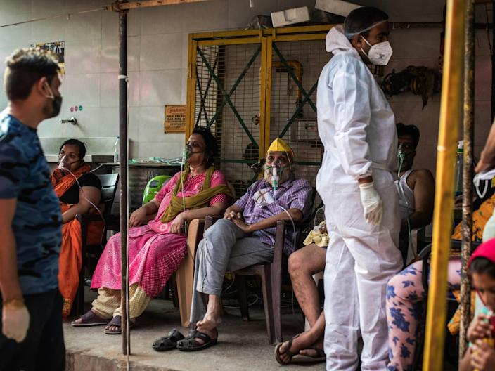 Patients suffering from Covid-19 are treated with free oxygen at a makeshift clinic in Indirapuram, Uttar Pradesh (Rebecca Conway/Getty Images)