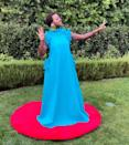 <p>brings the bold color to her own mini red carpet in a ruffle A-line Greta Constantine gown teamed with Lorraine Schwartz jewelry. </p>