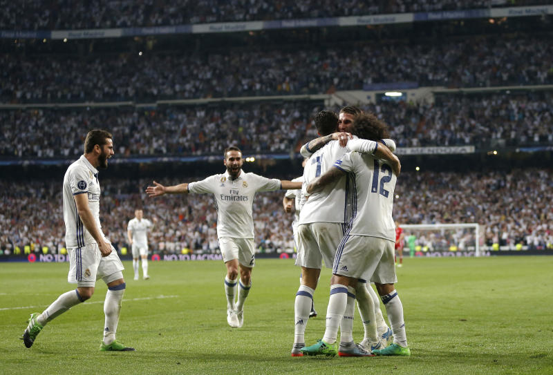 Real Madrid players celebrate after scoring their third goal during the Champions League quarterfinal second leg soccer match between Real Madrid and Bayern Munich at Santiago Bernabeu stadium in Madrid, Spain, Tuesday April 18, 2017. (AP Photo/Daniel Ochoa de Olza)