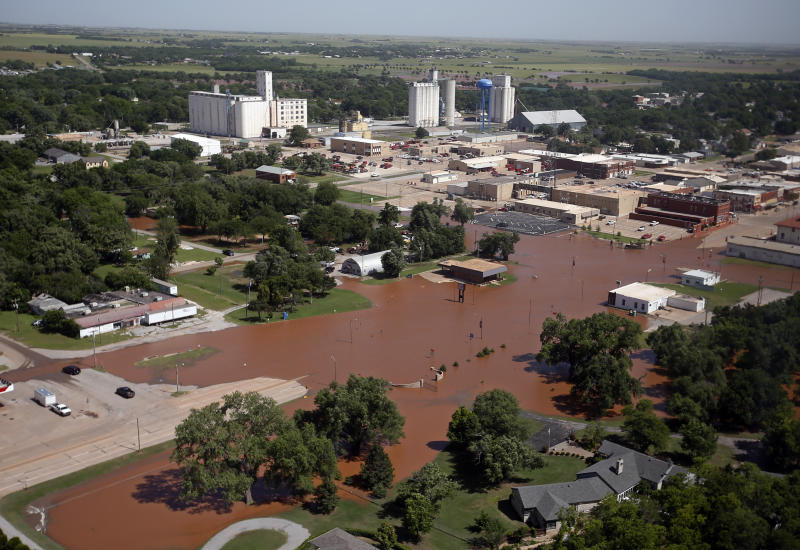Flooding in Kingfisher, Okla. is pictured Tuesday, May 21, 2019. Flooding following heavy rains was an issue across the state. (AP Photo/Sue Ogrocki)