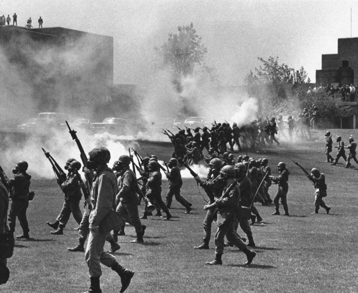 FILE - In this May 4, 1970 file photo, Ohio National Guard soldiers move in on war protestors at Kent State University in Kent, Ohio. Four persons were killed and multiple people were wounded when National Guardsmen opened fire. The school, about 30 miles southeast of downtown Cleveland, had planned an elaborate multi-day commemoration for the 50th anniversary Monday, May 4, 2020. The events were canceled because of social distancing restrictions amid the coronavirus pandemic. Some events, activities and resources are being made available online. (AP Photo, File)