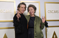 """Frances McDormand, left, winner of the award for best actress in a leading role for """"Nomadland,"""" and Yuh-Jung Youn, winner of the award for best actress in a supporting role for """"Minari,"""" pose in the press room at the Oscars on Sunday, April 25, 2021, at Union Station in Los Angeles. (AP Photo/Chris Pizzello, Pool)"""