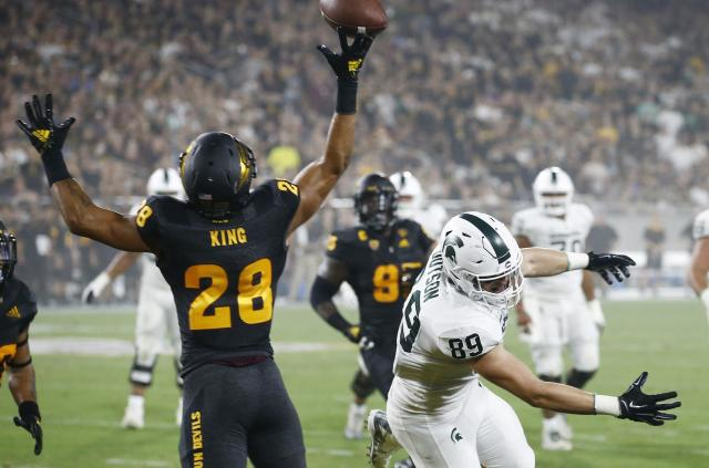 Arizona State defensive back Demonte King (L) tips a pass intended for Michigan State tight end Matt Dotson (R) during the first half of an NCAA college football game Saturday, Sept. 8, 2018, in Tempe, Ariz. (AP Photo/Ross D. Franklin)