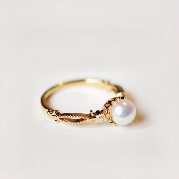 <p>This stunning <span>Pearl Engagement Ring</span> ($841) is made from solid 14k/18k gold.</p>