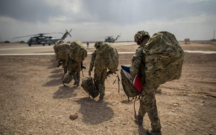 Carrying the Union Jack, the last British troops leave Camp Bastion, Helmand Province, Afghanistan - Ben Birchall