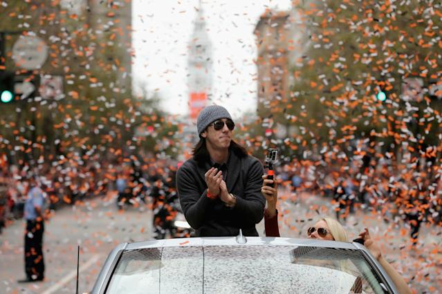 SAN FRANCISCO, CA - OCTOBER 31: Tim Lincecum #55 of the San Francisco Giants waves to the crowd during the San Francisco Giants World Series victory parade on October 31, 2012 in San Francisco, California. The San Francisco Giants beat the Detroit Tigers to win the 2012 World Series. (Photo by Ezra Shaw/Getty Images)