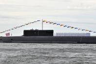 Sailors line up on a deck of the nuclear-powered ballistic missile submarine K-549 Knyaz Vladimir before the Navy Day parade in Saint Petersburg