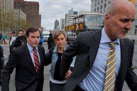 "Actress Allison Mack, known for her role in the TV series ""Smallville"", departs after being granted bail following being charged with sex trafficking and conspiracy in New York, U.S., April 24, 2018. REUTERS/Lucas Jackson"