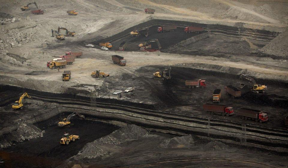 Vehicles work at an open-pit coal mine near Ordos. Inner Mongolia is China's second largest coal-producing region. Photo: AP