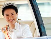 FILE PHOTO: Japan's new Empress Masako waves from her vehicle upon arriving at the Imperial Palace in Tokyo, Japan
